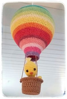 Handmade crocheted Amigurumi hot air balloon lamp in bright colours for nursery and kids room. Designad and Made by Elianna