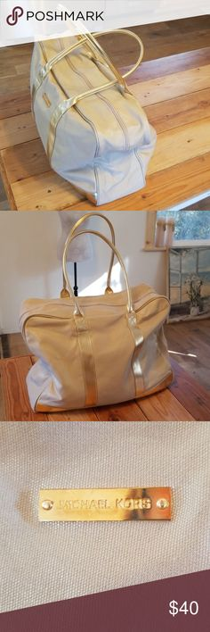 a27951a4b0f6 Michael Kors Weekend Getaway Tote Gold tones on canvas makes this MK tote  unique. The gold shimmers are beautiful making the slouchy bag luxurious.  Great ...