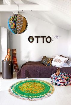 "We'd want a more colorful ""girly"" feel, but I like the low bed and area rug idea...."