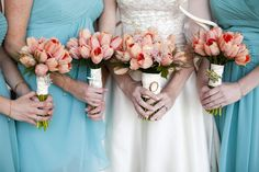 peach tulips and ranunculus, with the bride's great grandmother's ivory brooch on her bouquet. photo by Moments by Sarah
