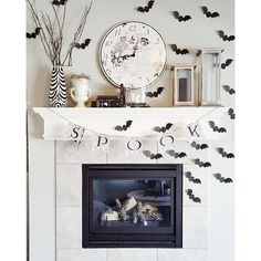Chic Black and White Halloween Mantel Decorations