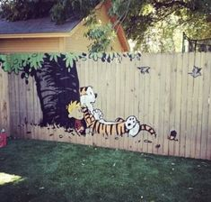 Calvin and Hobbes fence - I could so see this in your yard, Matt or lisa !
