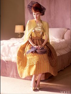 Karen Elson in a gold leather top and an organza circle skirt (spring 2008). Photographed by Mario Testino