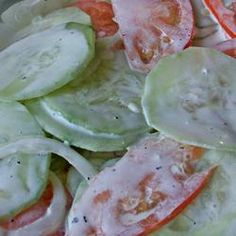 Refreshing Cucumber Salad -This is a quick and easy throw-together salad that is super tangy and creamy and a way to use up some of your fresh garden veggies. Very refreshing! Increase or decrease amount of vinegar and mayonnaise to your liking.