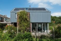 Image 9 of 20 from gallery of Zinc House / Proctor & Shaw. Photograph by David Millington Photography Ltd Prefab Shipping Container Homes, Zinc Roof, Second Floor, Terrace, Floor Plans, Outdoor Structures, Gallery, Building, Outdoor Decor