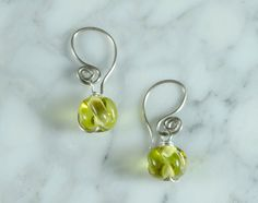 The Pacifik Image's Goodwin and Maxwell: Handmade sterling silver and lampworked recycled glass earrings. by ThePacifikImage on Etsy