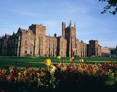 The Queens University of Belfast, Northern Ireland. The face of the university, the Lanyon Building, was built in 1849 in the Tudor Gothic style. Though not all of the university buildings adhere to this aesthetic, the red brick provides a warm welcome to all those who visit.