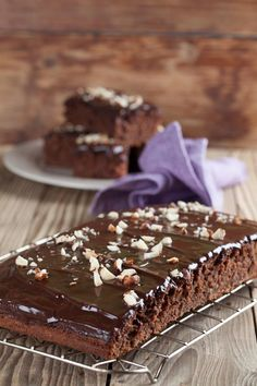 Moist Eggless Chocolate Cake Recipe - A moist and squidgy chocolate cake recipe made without eggs. Smother some chocolate ganache for that extra lusciousness. Sour Cream Chocolate Cake, Eggless Chocolate Cake, Sour Cream Cake, Chocolate Ganache, Cake Bars, Sweet Recipes, Cake Recipes, Dessert Recipes, Greek Desserts