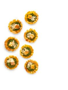 Get this all-star, easy-to-follow Squash Tartlets with Kale Pesto recipe from Food Network Magazine.