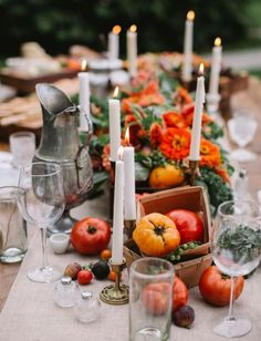 Eye-catching fall hues of orange and red in this edible early fall tablescape that's fresh from the farmers market with tomatoes and figs.