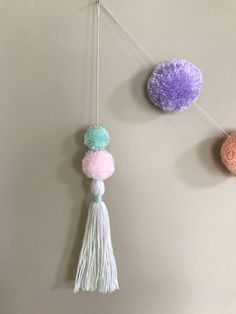 A personal favorite from my Etsy shop https://www.etsy.com/listing/520283554/pom-pom-tassel-drop