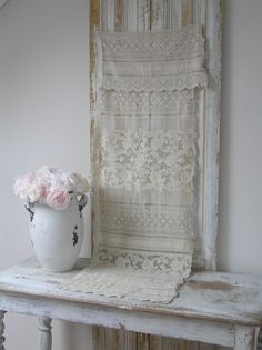 Pretty window dressing:  heavy cotton lace panel over light cotton patterned panel.  The loveliness of the lace with the privacy of a more covered window.