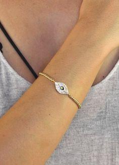 Jewel Cult - Crystal Eye Beaded Bracelet, $14.00 (http://www.jewelcult.com/crystal-eye-beaded-bracelet/)