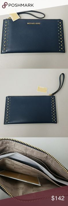 """NWT Michael Kors Jet Set Navy Clutch with Studs NWT Michael Kors Jet Set Navy Clutch with Wrislet with Goldtone Diamond Studded front trim and Goldtone hardware throughout.  This wristlet is a great weekend bag. Large enough to hold essentials and small enough to fit in a purse.  Interior lined in coordinating Michael Kors Signature tan fabric and features 1 open flap bill slot and 6 card slots.  Guaranteed authentic, flawless, unused and comes with tags.  10""""x5.5"""" with 6"""" drop strap in navy…"""