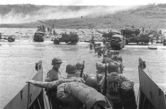 American troops waded ashore from a LCVP landing craft, Omaha Beach, Normandy, 6 Jun 1944