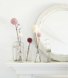 pompom flowers in glass vases @Allyson Angelini Drake  do you like this for my mantle gold mirror and plain glass vases maybe some books?