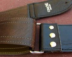 Cruelty-Free Couch Guitar Straps   The Brown Deadstock Luggage Guitar Strap