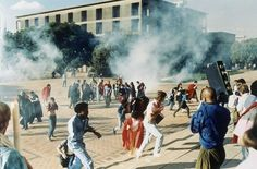 Clouds of teargas send students scurrying when police were sent to the University of Witwatersrand Campus in Johannesburg to disperse a gathering May 4, 1987. The police were acting under a last minute court order banning an open air meeting at which Winnie Mandela, wife of Nelson, jailed leader of the ANC, was to address the crowd of about 6000. Photo: JOHN PARKIN, Wire / AP1987 Winnie Mandela, Court Order, Nelson Mandela, Crowd, Acting, Police, University, Students, Wire