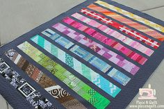 Piece N Quilt: Modern Row Quilt  I am loving the idea of rainbow colors and gray...