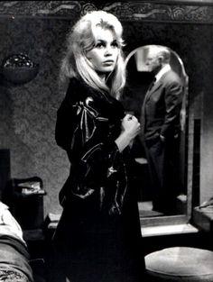 Bardot in a vintage Black Rubber Raincoat.