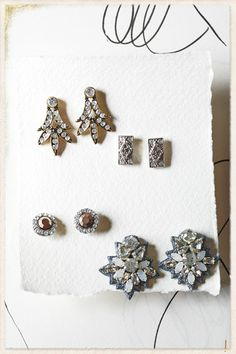 i just like the deco jewels with the simple lines and the paper texture. looks wintery! :)