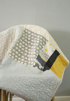 Grey and yellow crib quilt @Courtney Davies
