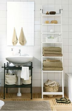 Don't forget to use wall space for extra storage in the bathroom. The HJALMAREN wall shelf paired with some small baskets and boxes can give your bathroom a clean and organized look, while still keeping everyday items within an arm's reach.