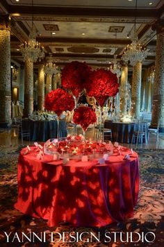 Lush red floral centerpieces atop of cascading martini glasses inside of a acrylic pool with floating candles and flowers. Apple Red Wedding, Red Rose Wedding, Wedding Flowers, Martini Glass Centerpiece, Red Centerpieces, Wedding Arrangements, Flower Arrangements, Glamorous Wedding, Luxury Wedding