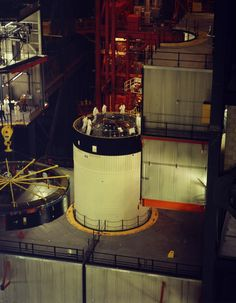 Workers prepare the S-IVB for mating of the Instrument Unit (pictured left), which houses the guidance, control and other systems of the Saturn V launch vehicle March 21, 1969