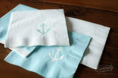 DIY Embossed napkins.  Simply stamp a cocktail napkin with an ink pad, sprinkle embossing powder on, shake off excess powder, and heat with embossing heat tool.  Instant personalized napkins perfect for any event.