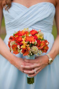 Ice blue + burnt orange | Loving this wedding #colorpalette | Gorgeous | Bridesmaid Bouquet | Miranda Laine Photography | http://www.weddingwire.com/wedding-photos/real-weddings/rustic-spring-texas-ranch-wedding/i/2ef07974421f03e6-adf0ed390b2a4b34/140831caa954182e