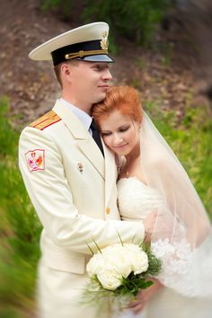 """Russian """"military"""" wedding. The groom is a naval officer in his parade uniform.  #bride #dress #Russian #weddings"""