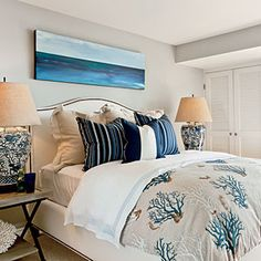 Add interest to your Singer Island condo guest room by mixing prints, like the stripe, coral, and chinoiserie patterns in this bedroom.