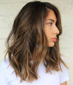 medium length dark brown hair with light brown highlights