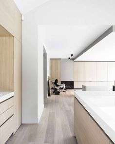 JUMA Architects transformed a 1976 bungalow into a contemporary Belgium villa with a pleasant holiday feeling. From Bungalow to Mansion Minimalism Interior, Apartment Interior, House Interior, Minimalist Living Room, Interior, Kitchen Design Small, Interior Design News, Kitchen Cabinets Decor, Cabinet Decor