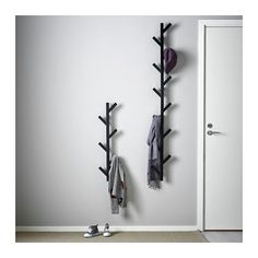 TJUSIG Hanger - black - IKEA For the space between his bdrm door and bookshelf, under his light switch.