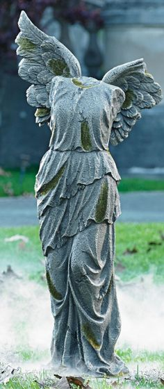 Designate your address as a Halloween graveyard with our incredibly realistic Lady Tombstone Collection. The worse-for-wear Winged Lady has lost her head and part of one wing.