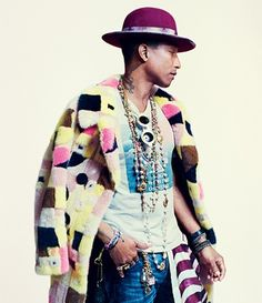 Pharrell Williams wearing rosary