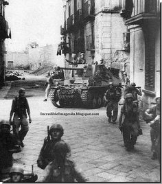 German paratroopers with a Marder (German tank destroyer) on the streets of Crete