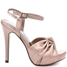 Chinese Laundry will have you dreaming about these elegant heels all night long. Dreamland has a blush satin upper with a knotted detail at the front of the vamp.  A 5 inch heel and 1/2 inch partial hidden platform finishes off this luxe satin pump.
