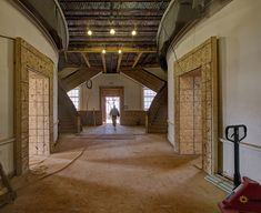 The stairways at the ground floor and first floor levels were restored to their historic appearance. The basement staircases were rebuilt and enclosed beneath the principal first floor stairs. The reconfiguration of the reconstructed stairs allows access to the windows facing the Lawn.