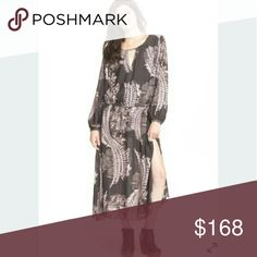 """Free People Out Of The Woods Maxi Dress A split hem accentuates the airy silhouette of a richly colored maxi dress, styled with a botanically inspired print. - Scoop neck - Long barrel sleeves - Slips on over head - Approx. 54"""" length (size Medium) - Imported Fiber Content: 100% polyester Free People Dresses Maxi"""