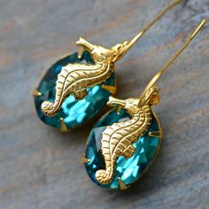 seahorse earrings @}-,-;--  Just saw earrings very much like these in Taromina, Italy.  Too expensive to buy but I did love them.