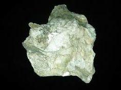 Polylithionite : KLi2Al(Si4O10)(F,OH)2.Pale green.Type Locality:Kangerdluarssuq Firth (Kangerdluarssuk; Kangerdluarsuk), Ilimaussaq complex, Narsaq, Kitaa Province (West Greenland), Greenland.