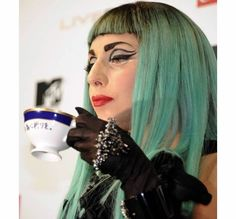 9af980d5bb59 US top entertainer Lady Gaga drinks tea with a  Play for Japan  sentence in  Japanese on the cup during a press conference of the MTV video Music Aid  Japan ...