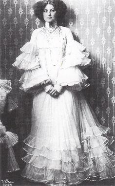 Fashion designer Emilie Flöge in a dress designed by Gustav Klimt