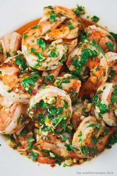 So delish! I made extra sauce and used it on orzo with broccoli! This grilled shrimp recipe with roasted garlic-cilantro sauce is an impressive appetizer! Charred prawns dressed in slightly spicy, robust flavors. Grilling Recipes, Fish Recipes, Seafood Recipes, Cooking Recipes, Healthy Recipes, Prawn Recipes, Recipes Dinner, Recipes With Cilantro