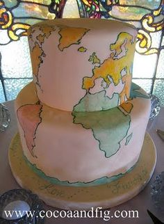 Hand Painted Old World Map Cake by Cocoa & Fig, a boutique bakery & dessert caterer located in the Twin Cities.