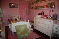 toddler girl room- like the long shelves