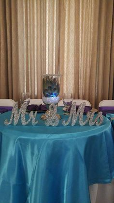 Peacock Themed Wedding (Malibu Blue and Purple) www.crystalsweddingsandevents.com